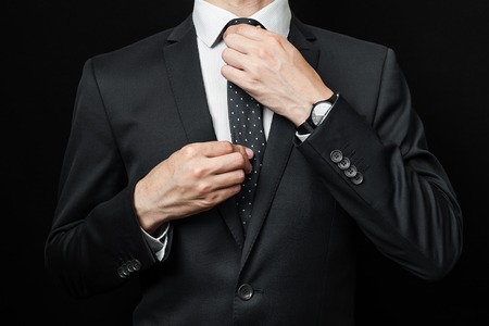Photo for man in suit on a black background. studio shot - Royalty Free Image