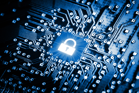 Foto de Lock on computer chip - technology security concept - Imagen libre de derechos