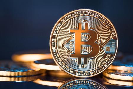 Foto de Golden Bitcoins on a blue background - Imagen libre de derechos