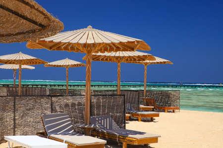 Foto de Egyptian parasol on the beach of Red Sea. Marsa Alam, Egypt. - Imagen libre de derechos