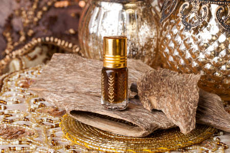 Photo for Agarwood, also called aloeswood, essential oil and incense chips - Royalty Free Image