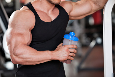 Photo for young professional bodybuilder in the gym, drinking a protein shake - Royalty Free Image