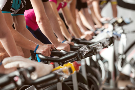 Foto per gym detail shot - people cycling; spinning class - Immagine Royalty Free
