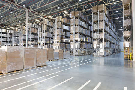 Photo for Huge distribution warehouse with boxes on high shelves - Royalty Free Image