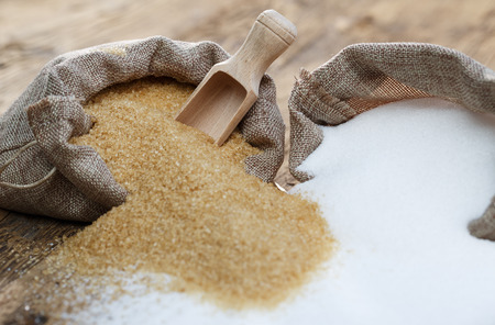 Photo for Various types of sugar, brown sugar and white - Royalty Free Image