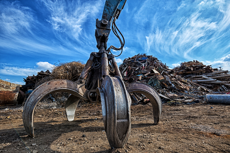 Foto de Gripper excavator on a scrap yard. HDR - high dynamic range - Imagen libre de derechos