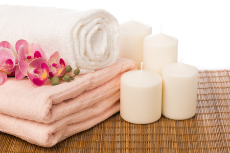 Photo pour Spa still life with aromatic candles,orchid flower and towel. - Image - image libre de droit