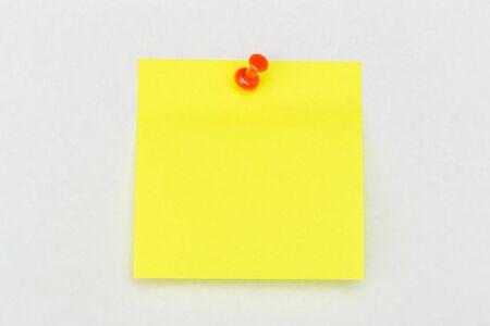 Foto de Note with a paper clip. Isolated on a white background - Image - Imagen libre de derechos