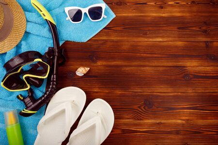 Photo for Vacation travel equipment Straw hat, sunglasses And marine objects, shells, on wooden floor - Royalty Free Image