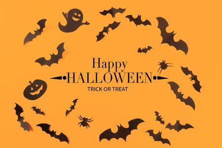 Photo pour Halloween paper decorations on orange background. Halloween concept. Flat lay, top view, copy space - image libre de droit