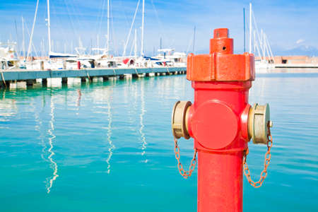 Photo pour Red hydrant in a italian harbor - concept image with copy space - image libre de droit