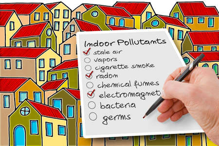 Photo pour Hand write a check list of indoor air pollutants against a buildings background - concetp image with copy space - image libre de droit