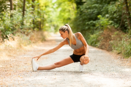 Photo pour Young sexy blonde woman is doing stretching exercises  - image libre de droit