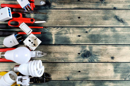 Photo pour Close-up of work tools and electrical equipment on an antique wooden table with space for text / announcement - image libre de droit