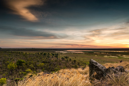 Photo for Dusk at Ubirr rock looking down at the sun reflected in the waters of the Nadab floodplains. Northern Territory, Australia - Royalty Free Image