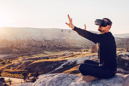 Foto de The man with glasses of virtual reality. Future technology concept. Modern imaging technology. - Imagen libre de derechos