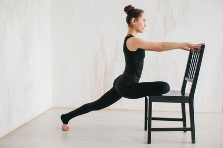 Foto de Young beautiful woman practicing yoga and gymnastic. Wellness concept. Classes in single sports. - Imagen libre de derechos