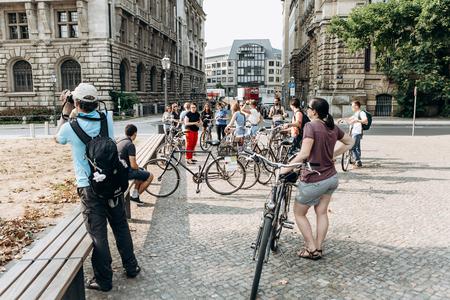 Foto de Germany, Leipzig, September 6, 2018: A group of tourists riding bikes sightseeing. Excursion on the bike - Imagen libre de derechos