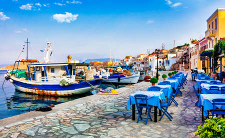 Photo for traditional Greece - old fishing boats and tavernas, Chalki island - Royalty Free Image
