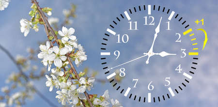 Foto de Daylight Saving Time. DST. Wall Clock going to winter time. Turn time forward. Abstract photo of changing time at spring. - Imagen libre de derechos