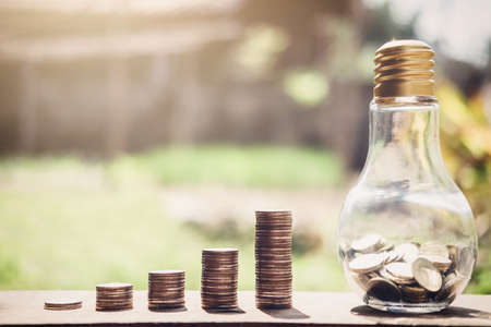 Foto de Stacking coins and money growing for saving, Coin in glass bottle with money stack for business planning investment. - Imagen libre de derechos