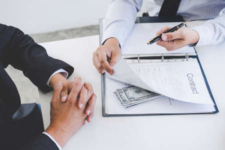 Photo for Bribery and corruption concept, bribe in the form of dollar bills, Businessman giving money while making deal to agreement a real estate contract and financial accounting. - Royalty Free Image