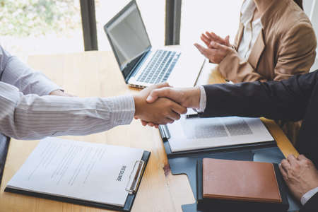 Photo for Greeting new colleagues, Handshake while job interviewing, male candidate shaking hands with Interviewer or employer after a job interview, employment and recruitment concept. - Royalty Free Image