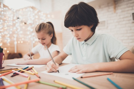 Photo for Children at table at home. Brother and sister are drawing with color pencils. - Royalty Free Image