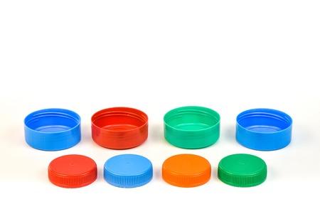 Photo pour Plastic bottle screw caps isolated on white background - image libre de droit