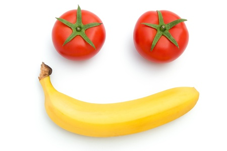 fresh tomatoes and carrot shape like smiling face