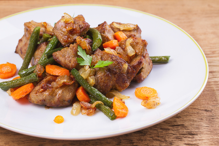 Photo for Sauteed liver with vegetables on white plate - Royalty Free Image