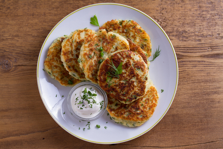 Photo for Herb and Cheese Mashed Potato Cakes. Potato Pancakes. Vegetable fritters. View from above, top studio shot - Royalty Free Image