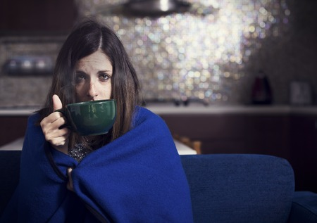 Foto de young sick girl drinking herbal tea - Imagen libre de derechos