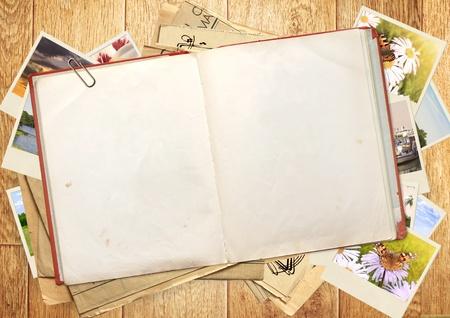 Foto de Old book and photos. Objects over wooden plank - Imagen libre de derechos