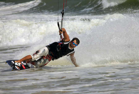 Kiteboarder enjoy surfing in ocean. Vietnam