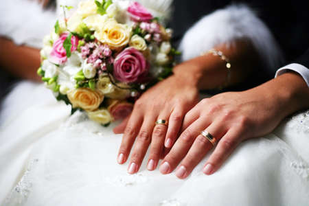 Photo for Hand of the groom and the bride with wedding rings - Royalty Free Image