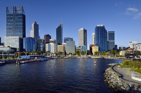 Photo for Perth, WA, Australia - November 27, 2017: Skyline from Perth on Swan river with different buildings and Spanda sculpture on Elizabeth Quay esplanade - Royalty Free Image