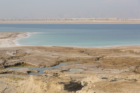Foto de View on a pitfall, sinkholes and conversions of the Dead Sea coast, Jordan - Imagen libre de derechos