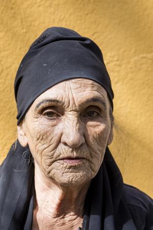 Khorog, Tajikistan August 25 2018: Beautiful old Tajik woman with headscarf and deep facial wrinkles in Khorog, Tajikistan