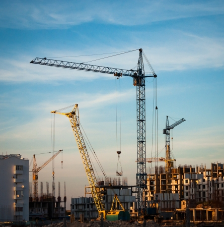 Photo pour Construction site with building cranes - industrial landscape  - image libre de droit