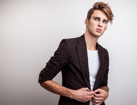 Photo pour Elegant young handsome man  Studio fashion portrait   - image libre de droit