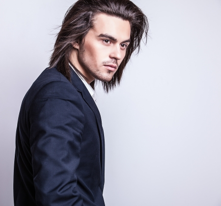 Portrait of handsome long-haired stylish man