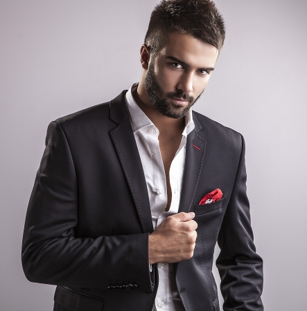 Foto de Elegant young handsome man  Studio fashion portrait    - Imagen libre de derechos