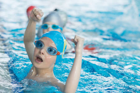 Foto de young and successful swimmers pose - Imagen libre de derechos