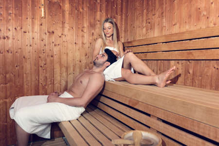 Photo for Happy couple enjoying the sauna together at the spa - Royalty Free Image