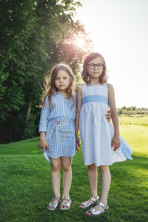 Photo for Two girls standing on the field. - Royalty Free Image