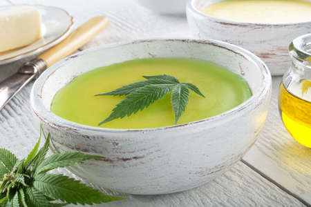 Photo for Delicious homemade cannabis butter with marijuana leaf garnish. - Royalty Free Image