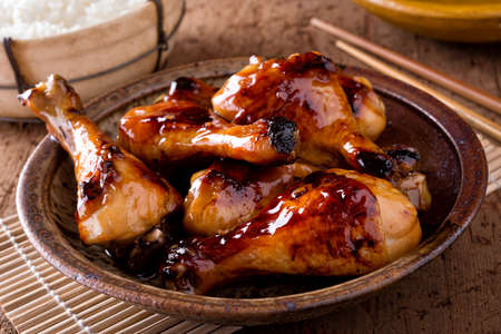 Photo for A bowl of delicious honey garlic chicken drumsticks with rice. - Royalty Free Image