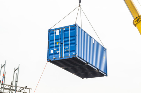 Photo for Blue building containers, cargo containers, residential containers at a loading crane. - Royalty Free Image