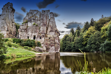 Photo for The Externsteine, striking sandstone rock formation in the Teutoburg Forest, Germany, North Rhine Westphalia - Royalty Free Image